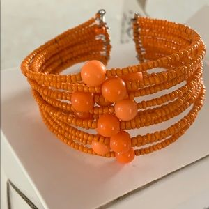 Orange bracelet.